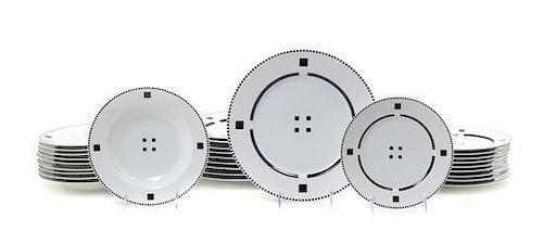 * A Swid Powell Porcelain Dinner Service for Ten, Diameter of dinner plate 11 inches.