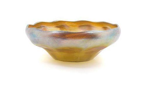 A Tiffany Studios Gold Favrile Glass Bowl, Diameter 10 inches.