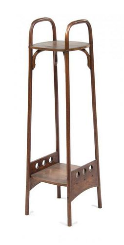 An Otto Prutscher Mahogany Etagere, for Thonet, Height 48 1/8 x width 12 1/4 x depth 13 1/2 inches.