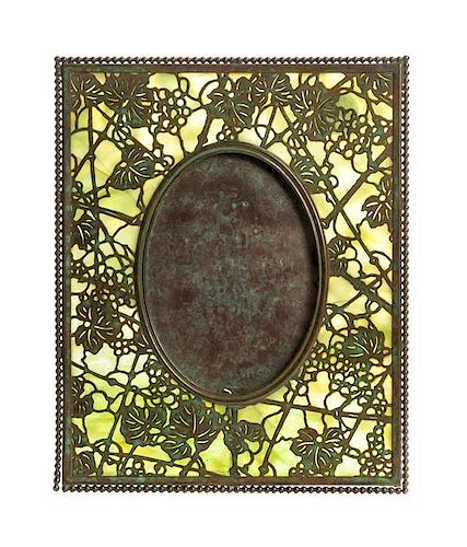 A Tiffany Studios Bronze and Favrile Glass Picture Frame, Height 10 inches.