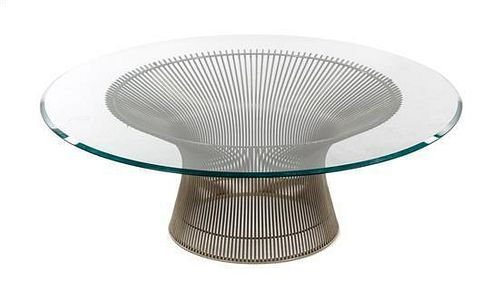 A Warren Platner Glass and Chromed Low Table, Height 14 3/4 x diameter 42 inches.