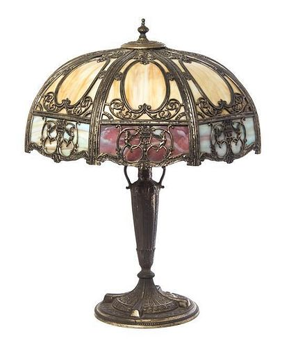 A Silvered Metal and Slag Glass Table Lamp, Height overall 22 1/4 x diameter of shade 20 1/2 inches.