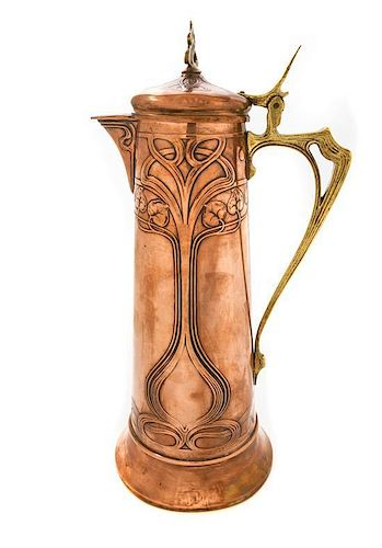* A WMF Art Nouveau Brass and Copper Ewer, Height 17 1/4 inches.