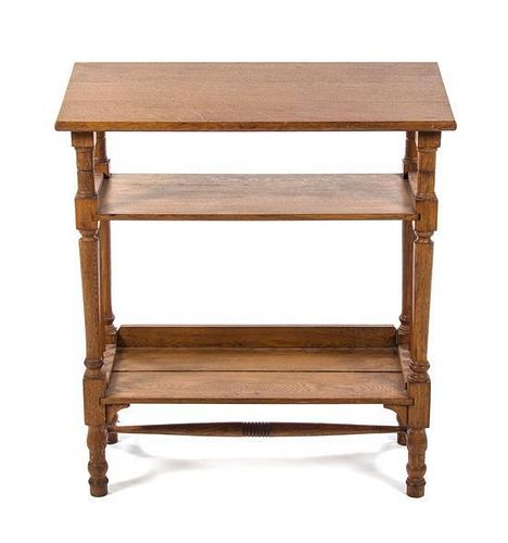 An English Oak Etagere, Leonard Wyburd for Liberty & Co., Height 31 x width 27 3/4 x depth 13 inches.