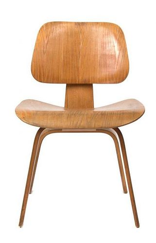 * A Charles and Ray Eames Bentwood DCW Chair, Height 27 inches.