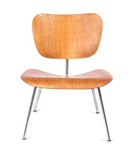* A Charles and Ray Eames Walnut DCM Chair, Height 27 inches.