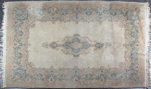 A Kirman Wool Rug, 9 feet 2 inches x 5 feet 9 inches.