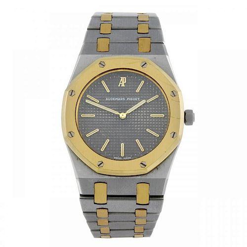 AUDEMARS PIGUET - a mid-size Royal Oak bracelet watch. Stainless steel case with yellow metal bezel.