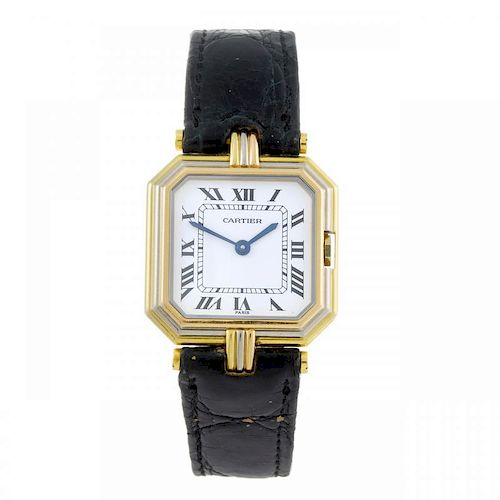 CARTIER - a Coussin wrist watch. Yellow metal case, stamped 18k 750, with tri-colour bezel. Numbered