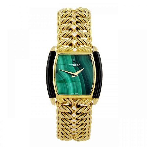 CORUM - a lady's bracelet watch. Yellow metal case, stamped 18k with poincon. Numbered 27630N48 1824