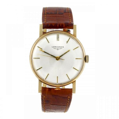 LONGINES - a gentleman's wrist watch. 9ct yellow gold case with engraved case back, hallmarked Londo