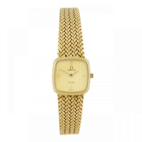 OMEGA - a lady's De Ville bracelet watch. Gold plated case with stainless steel case back. Numbered