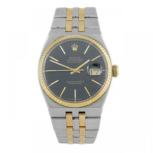 ROLEX - a gentleman's Oysterquartz Datejust bracelet watch. Circa 1987. Stainless steel case with ye