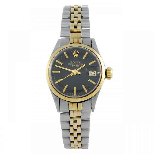 ROLEX - a lady's Oyster Perpetual Date bracelet watch. Circa 1968. Stainless steel case with yellow