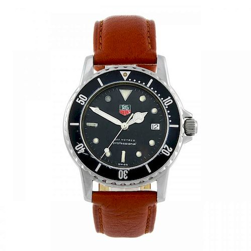 TAG HEUER - a gentleman's 1500 Series wrist watch. Stainless steel case with calibrated bezel. Refer