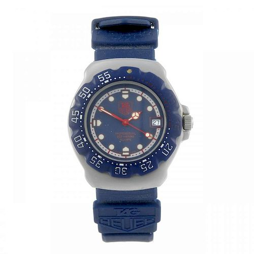 TAG HEUER - a mid-size Formula 1 wrist watch. Stainless steel case with plastic calibrated bezel. Nu