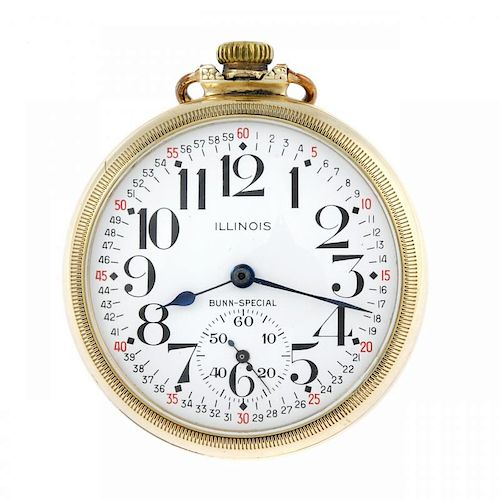 An open face railway grade pocket watch by Illinois Watch Co. Gold plated case, numbered 7885980. Si