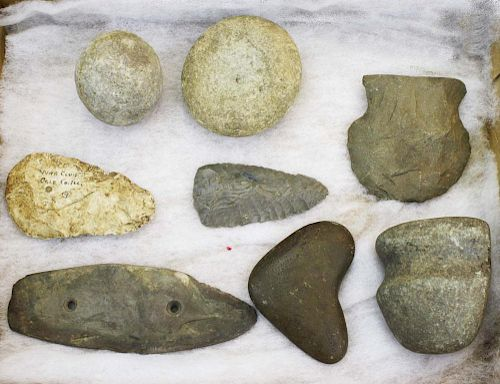 Illinois lithic artifacts including ground stone axe, hammer