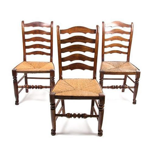 A Set of Six Provincial Oak Ladderback Chairs Height 38 inches.