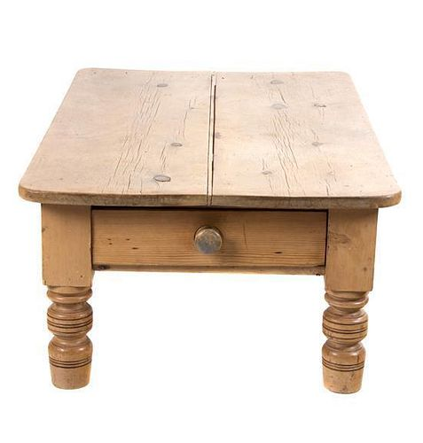 A Provincial Style Pine Low Table Height 18 1/4 x length 47 1/2 x depth 30 1/4 inches.