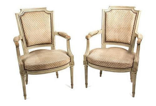 A Pair of Louis XVI Style Painted Fauteuils Height 34 inches.