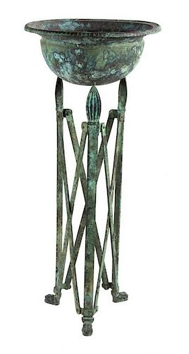 An Etruscan Style Patinated Metal Jardinière Height 41 1/2 inches.