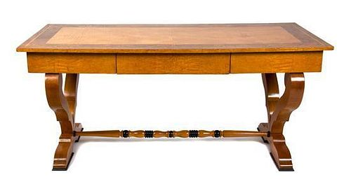 A Biedermeier Birch and Burlwood Writing Table Height 29 3/4 x width 66 x depth 29 1/2 inches.