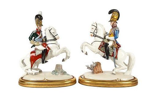 A Pair of Nymphenberg Porcelain Military Figures on Horseback Height 13 1/2 inches.