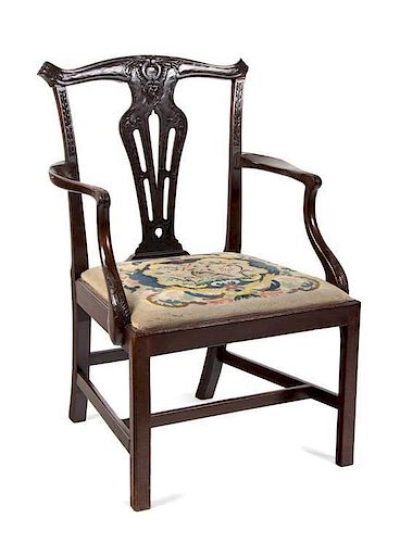 A Chippendale Style Mahogany Armchair Height 37 inches.