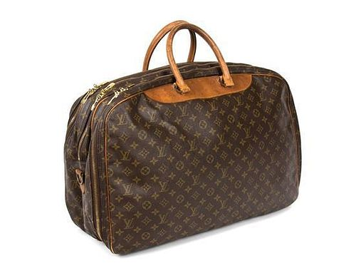 A Louis Vuitton Soft Sided Weekend Travel Bag Height 17 x width 23 inches.