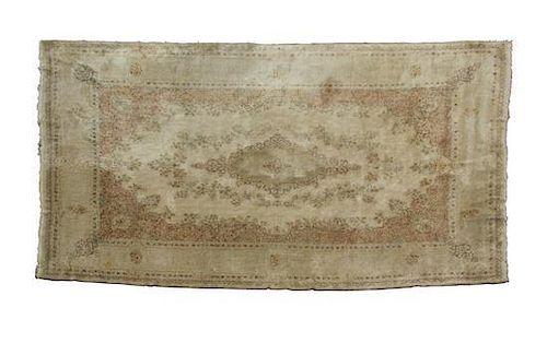 A Kerman Wool Rug 19 feet 5/8 inches x 11 feet 7 inches.