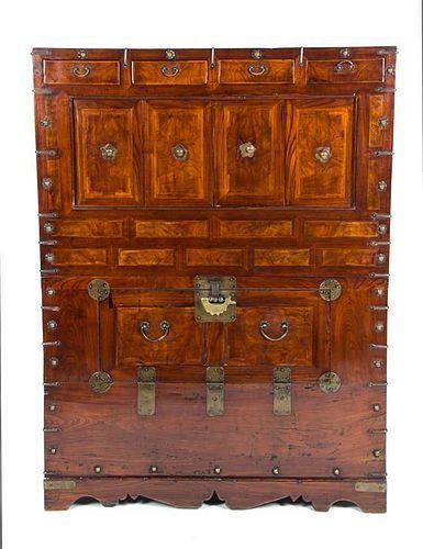 A Korean Elmwood Storage Cabinet Height 46 1/2 x width 15 1/2 x depth 34 1/2 inches.
