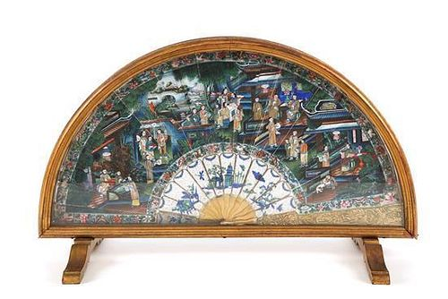 A Chinese Gilt Metal Mounted Paper Folding Fan Height 12 3/4 x length 21 1/2 inches.