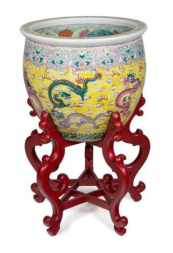 A Chinese Export Porcelain Jardinière Jardinière height 19 x diameter 21 1/2 inches, stand height 23 1/2 inches.