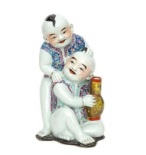 A Chinese Polychromed Ceramic Figural Group Height 15 inches.