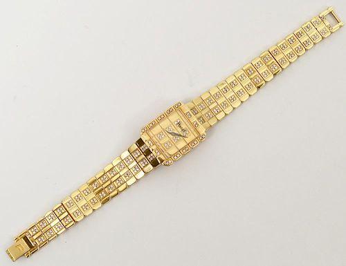 PIAGET EIGHTEEN KARAT YELLOW GOLD AND DIAMOND WATCH