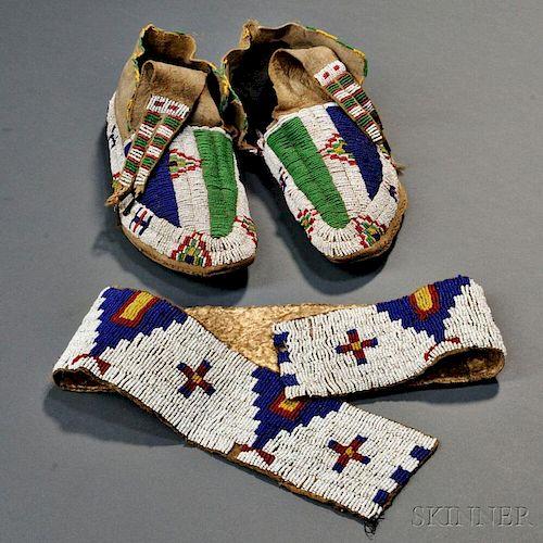 Pair of Lakota Buffalo Hide Moccasins and a Single Legging Strip