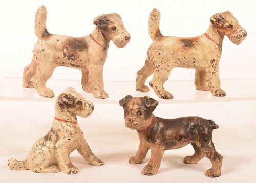 Four Various Hubley Dog Figures.