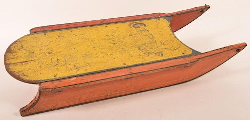 Painted wooden child's sled with iron runners