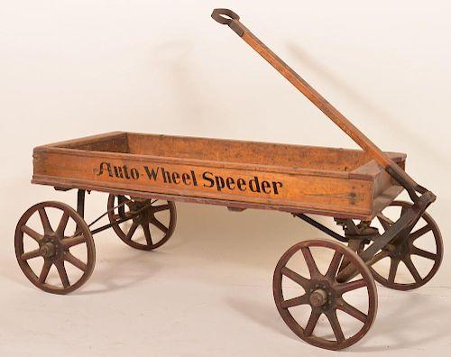 """Wooden pull wagon stenciled """"Auto Wheel Speeder"""""""