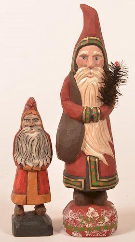 2 Folk Art Santa carving by Johnathon Bastian.