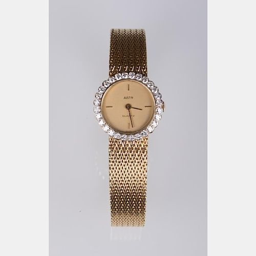 An Austin Quartz 14kt. Yellow Gold and Diamond Ladies Wrist Watch,