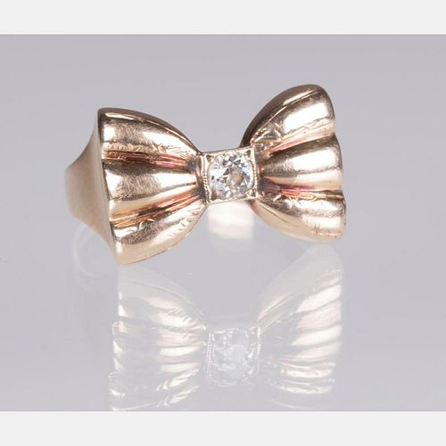 A 14kt. Yellow Gold and Diamond Bow Form Ring,