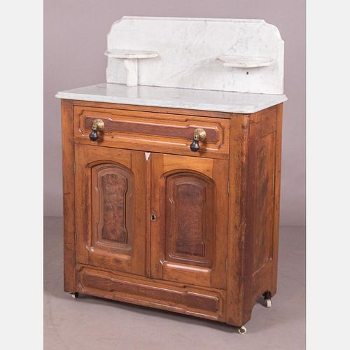 A Victorian Walnut and Marble Washstand, 19th Century.
