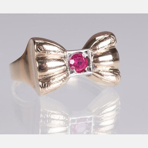 A 10kt. Yellow Gold and Ruby Bow Form Ring,