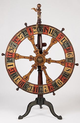 Will & Finck Gambling Wheel. San Francisco, 818 Market St., ca. 1900. The only known example, original polychrome-painted, walnut wall-mounted saloon