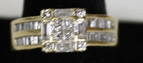 14k y.g. ladies ring having 8 small square cut diamonds and 4 baguette cut diamond. Each side has 2