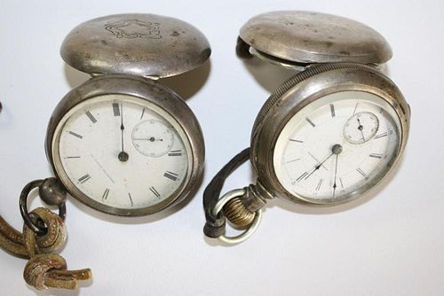 Two open face coin silver American Watch Co. pocket watches. One key wind.