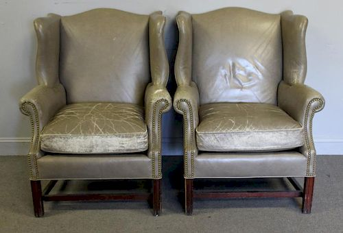 Pair of Leather Upholstered Wing Arm Chairs.