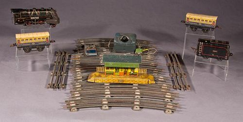 Nineteen Piece French Tin Toy Train Set, 20th c.,